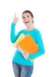 Young beautiful student woman holding workbook and pointing up. Royalty Free Stock Photo