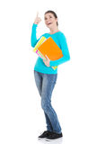 Young beautiful student woman holding workbook and pointing up. Stock Images