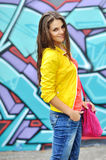 Young beautiful stylish girl with bag Stock Images