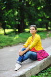 Young beautiful stylish girl with bag in a summer park Stock Image