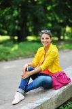 Young beautiful stylish girl with bag in a summer park Royalty Free Stock Photography