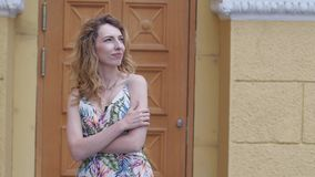 Young beautiful stylish girl posing at the summer city streets on a sunny day. stock footage