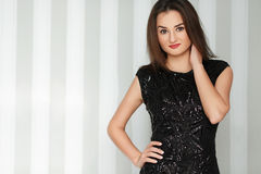 Young beautiful stylish girl with red lips posing in amazing elegant evening  black dress. Royalty Free Stock Photos