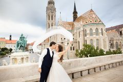 Young beautiful stylish pair of newlyweds kissing by the Fisherman`s Bastion in Budapest, Hungary stock photos