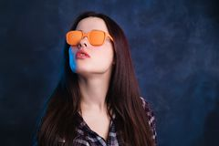 Young beautiful stylish woman in orange vintage sunglasses. Fash Royalty Free Stock Photography