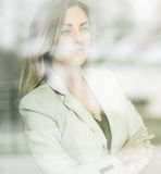 Young beautiful successful business woman standing near the wind Stock Image