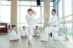 Young, beautiful, successful multi ethical kids in karate positi Stock Photography