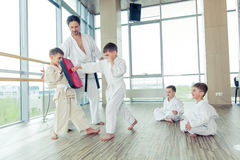 Young, beautiful, successful multi ethical kids in karate position Stock Photos