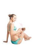 Young beautiful  summer girl sitting on floor and Stock Image