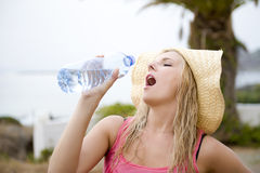 Young beautiful summer woman with bottle of water Royalty Free Stock Photos