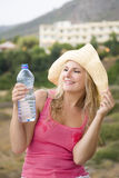 Young beautiful summer woman with bottle of water Stock Photography