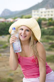 Young beautiful summer woman with bottle of water Royalty Free Stock Photo