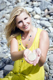 Young beautiful summer woman holding small stones Stock Images