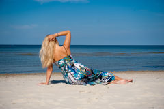 Young beautiful summer woman meditating on the sea Stock Photography