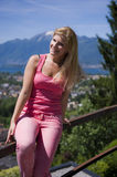 Young beautiful summer woman outdoors. mountains. Young beautiful summer woman outdoors in front of the mountains Stock Photos