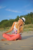 Young Beautiful Summer Woman Sitting On The Beach Royalty Free Stock Images