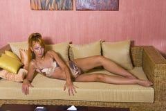 Young beautiful sunburnt woman lays in bikini Stock Photos
