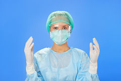 Young beautiful surgeon doctor (woman) Stock Images