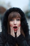 Young beautiful surprised girl at winter outdoor Royalty Free Stock Images