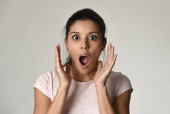 Young beautiful surprised woman amazed in shock and surprise with mouth big opened Stock Photo