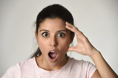 Young beautiful surprised woman amazed in shock and surprise with mouth big opened Stock Photos