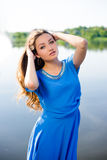Young beautiful surprized girl standing by river Stock Photos