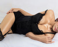 Young beautiful tanned Sexy Asian woman wearing elegant lingerie Royalty Free Stock Images