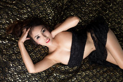 Young beautiful tanned Sexy Asian woman wearing elegant lingerie Stock Photo