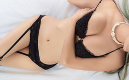 Young beautiful tanned Sexy Asian woman wearing elegant lingerie Royalty Free Stock Photography