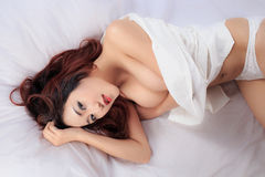 Young beautiful tanned Sexy Asian woman wearing elegant lingerie Royalty Free Stock Image