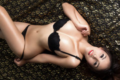 Young beautiful tanned Sexy Asian woman wearing elegant lingerie Stock Photos