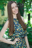 Young beautiful teen girl in summer park Stock Photo