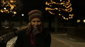 Young Beautiful Teen Girl Walking At Night In City Smiling. 4K UHD stock footage