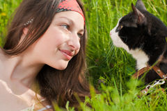 Young beautiful teenage girl & cat outdoors Stock Image