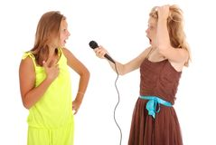 Young beautiful teenage girl conducts interviews with the singer royalty free stock photo