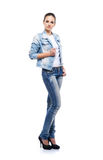Young and beautiful teenage girl in denim jeans Stock Images