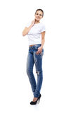 Young and beautiful teenage girl in denim jeans Stock Photography