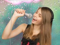Young beautiful  teenage girl singing Stock Photos
