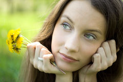 Young beautiful teenager with dandelion bouquet Stock Photo