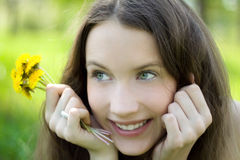 Young beautiful teenager with dandelion bouquet. Young beautiful teenager portrait with dandelion bouquet smile Stock Image