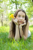 Young beautiful teenager with dandelion lawn Royalty Free Stock Photo