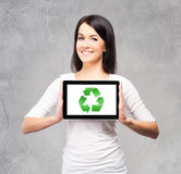 Young and beautiful teenager girl holding an ipad Stock Photography