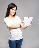 Young and beautiful teenager girl holding an ipad Royalty Free Stock Photography