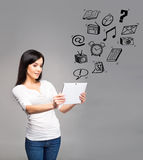 Young and beautiful teenager girl holding an ipad tablet pc in h Royalty Free Stock Photos