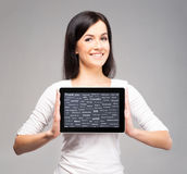 Young and beautiful teenager girl holding a tablet computer Stock Photos