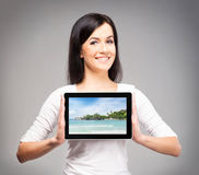 Young and beautiful teenager girl holding a tablet Stock Image