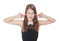 Young beautiful teenager girl plugging ears with fingers isolate Royalty Free Stock Images
