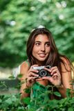Young beautiful tourist woman using a photo camera stock photo