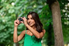 Young beautiful tourist woman using a photo camera royalty free stock photography
