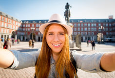 Young beautiful tourist woman visiting Europe in holidays exchange students and taking selfie picture. In town smiling happy on sunny day in travel and Royalty Free Stock Photos